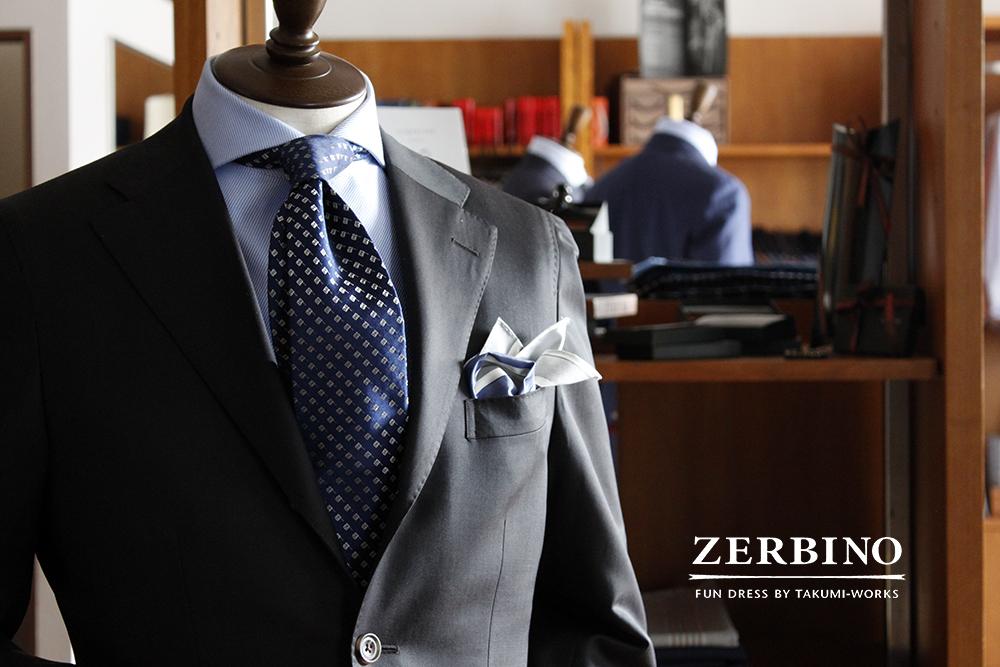brown suit & navy tie
